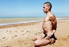 Man in meditation yoga pose Stock Image