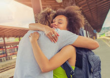Man meeting his girlfriend at the train station. Man meeting his girlfriend from her trip at the train station. Close up royalty free stock images