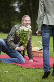 Man meets woman with flowers Stock Photography
