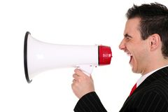 Man with Megaphone. Business Man Shouting Through Megaphone Royalty Free Stock Image