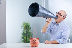 Man megaphone and pig mean savings Stock Images