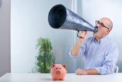 Man megaphone and pig mean savings Stock Images