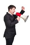 Man with megaphone. Portrait of young man shouting with megaphone against a white background Royalty Free Stock Image