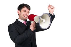 Man with megaphone. Portrait of young man shouting with megaphone against a white background Stock Image