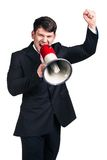 Man with megaphone. Portrait of young man shouting with megaphone against a white background Stock Photos
