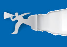 Man with megaphone ripping paper. Man advertises or sells shouts in a megaphone on the blue paper background with place for your text or image.  Template  for a Royalty Free Stock Image