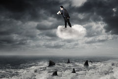 Man with megaphone shouting on the cloud Stock Image