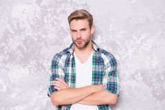 Man among men. barbershop concept. mens sensuality. sexy guy casual style. macho man grunge background. male fashion