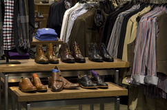 Man men fashion clothing shoe store. High quality mans clothing and shoe store in a mall Stock Image