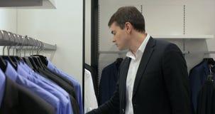 Man in Menswear Store stock video