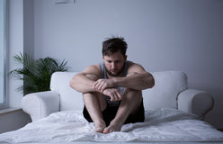 Man after mental breakdown. Image of man after mental breakdown sitting in bed Royalty Free Stock Photo