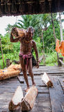 Man Mentawai tribe comes back home from hunting. Stock Image