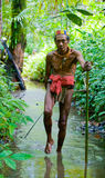 Man Mentawai tribe is going in the jungle. stock photography