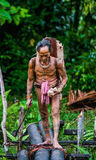 Man Mentawai tribe is going in the jungle. Stock Photo