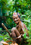 Man Mentawai tribe in the jungle collecting plants. royalty free stock image