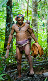 Man Mentawai tribe in the jungle collecting plants. stock photography