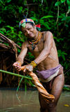Man Mentawai tribe in the jungle makes his clothes from the tree bark. Royalty Free Stock Photo