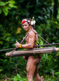 Man Mentawai tribe in the jungle. MENTAWAI PEOPLE, WEST SUMATRA, SIBERUT ISLAND, INDONESIA – 03 OKTOBER 2011: Man Mentawai tribe in the jungle stock photography