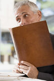 Man with a menu Stock Photo