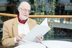 Man with menu Stock Images