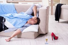 The man with mess at home after house party. Man with mess at home after house party Stock Image