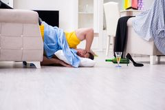 The man with mess at home after house party. Man with mess at home after house party Stock Images