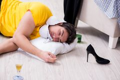 The man with mess at home after house party. Man with mess at home after house party Royalty Free Stock Photos