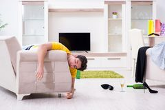 The man with mess at home after house party. Man with mess at home after house party Royalty Free Stock Image