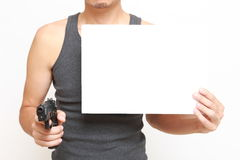 Man with a message board threatens by a gun. Concept shot of climb ans justice Royalty Free Stock Image