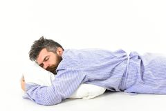 Man with messy hair sleep, heavy sleeper, white background. Fast asleep concept. Man with sleepy face lies on pillow. Hipster with beard and mustache sleep Royalty Free Stock Image