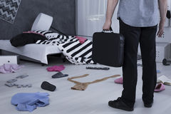 Man in messy room Royalty Free Stock Photos