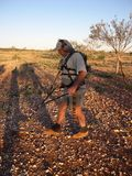 Man metal detecting for gold nuggets Stock Photo