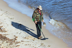 Man with metal detector. On the river shore.Ukraine royalty free stock images