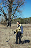 Man with metal detector. Military archeology. Man with metal detector on the battlefield of WW2.Ukraine royalty free stock image
