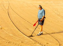 Man with metal detector on the beach of Tossa de stock photography