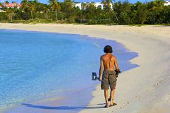 Man with a metal detector on the beach Stock Photos