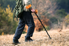 Man and metal detector. Man hunt treasure with metal detector in autumn forest royalty free stock photos