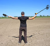 Man with metal detector Royalty Free Stock Images