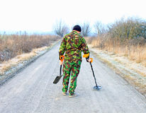 Man with metal detector . Royalty Free Stock Images