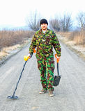 Man with metal detector . Royalty Free Stock Image