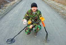 Man with metal detector . Royalty Free Stock Photo