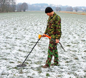 Man with metal detector . Stock Images
