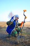 Man with metal detector . Stock Photos
