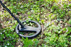 Metal detector. A man with a metal detector in the woods looking for vintage items and valuable coins royalty free stock photos