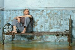 Man on the metal rusty bed Stock Images