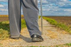 Man with metal walking stick doing hard step outdoor Royalty Free Stock Photos