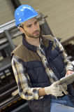 Man in metallurgic manufacture using digital tablet Stock Photography