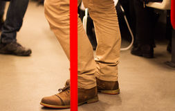 Man in the metro with special legs and shoes Royalty Free Stock Images