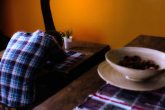Man in a Mexican bar got drunk and fell asleep sitting alone. On a chair at the table stock photos