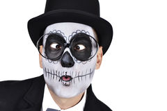 Man with a mexican calaveras makeup crossing his eyes Stock Photo